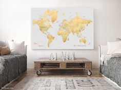 """Personalized large & highly detailed world map canvas print or push pin map in gold and gray. """"Everly"""". Personalized large and highly detailed world map gallery wrap canvas print or push pin map, in light grey and faux gold foil effect. The map comes with many cities, capitals, countries, states and mayor rivers labelled. We can add a custom quote, a couple names, a baby name, family name + date, or a custom key for the map."""