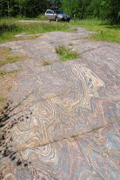Folded banded iron formation with shale interbeds, exposed in a pavement near Soudan, Minnesota. This is so cool! I would love to have this for a counter top.