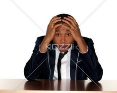 man stressed out - Man in business attire looking stressed out.