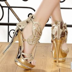 Metallic Gold Stiletto Platform heels with three rhinestone studded toe straps. Gold Studded Butterfly pattern ankle straps.