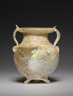 A miniature jar of free-blown colorless glass. Ancient Romans, Ancient Art, Glass Vessel, Glass Art, History Of Glass, Roman Artifacts, Antique Glass Bottles, Classical Antiquity, Getty Museum
