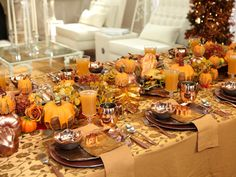 Festive Thanksgiving  Fake gourds, flowerpot molds, fall leaves, branches and lots of copper (from the charger plates to the three-tiered dessert stand) blend together in Sandra's turkey-day tablescape to create an earthy, metallic decor.