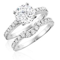Round brilliant cut diamond solitaire engagement ring with prong-set diamonds on the band with matching wedding band. #engagement #ring #diamond