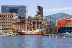 Buildings at the waterfront, National Aquarium, Inner Harbor, Baltimore, Maryland, USA - Glowimages/Getty Images