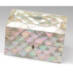 Mother of Pearl box, square form with inlaid mother of pearl in all over geometric design, inside contains a cut glass bottle, c. 1900