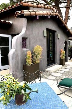 A House Perched On A Hill And A Cute Spanish Style Home - California Home Tours Part 2 — DESIGNED - California Spanish style home gray exterior with clay tile roof and succulents - Stucco Exterior, Grey Exterior, Exterior House Colors, Exterior Homes, Mediterranean Homes Exterior, Mediterranean Home Decor, Tuscan Homes, Mediterranean Architecture, Spanish Style Homes