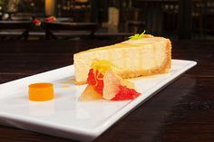 Ginger cheesecake wtih orange and aperol liqueur jelly, segments and reduction from pink grapefruit