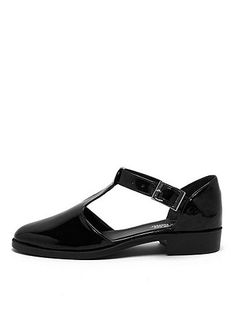 Jane Flat - classic T-strap sandal features a vegan leather upper and buckle closure. Made in USA.