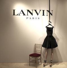 Lanvin Promotional, Abstract window display! Love how it first appears that the dress is supported by a mannequin but actually it is hanging on a hanger.