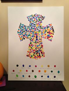 Easter Cross made with a different coloured finger print for each child