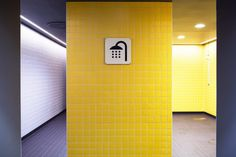 Pops of colour appear in the form of a bright green multi-sports court and a wall of acid-yellow tiles in the changing room showers. Metal Facade, Metal Screen, White Ceiling, White Walls, Sidney White, Diving Pool, Yellow Tile, Nordic Lights, Clerestory Windows