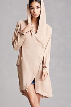 A woven jacket featuring a wrap front with zipper closure, drawstring hood, long sleeves with button cuffs, flap pockets with snap-button closure, an asymmetrical hem, and a back slit. This is an independent brand and not a Forever 21 branded item.