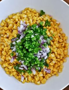 Great on a salad with chicken, makes a good change! Chipotle's corn salsa makes a big bowl 1 12-ounce bag of frozen sweet yellow corn, defrosted and drained 2 medium-sized jalapenos, seeded and chopped (leave in some seeds for more heat if desired) 1/2 red onion, finely chopped (about 1/3 cup) 3/4 cup fresh cilantro, torn or chopped the juice of 2 (juicy!) limes 1/2 teaspoon salt 1/2 teaspoon pepper