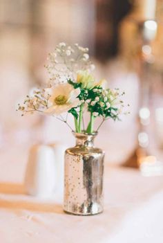 Small-mercury-silver-vases-with-delicate-flowers-for-top-table-Ettington-Park-Wedding-Flowers