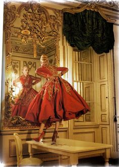 """Golden Years"" Vogue UK, October 2007  photographer: Corrine Day Jessica Stam  in the Norfolk House Music Room, Victoria & Albert Museum  red dress surrounded by all kinds of molding, paneling, gold gilding, and other ornate Rococo"