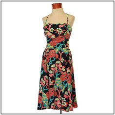 BEAUTIFUL! This dress is stunning. The fabric is strong and soft with TONS of swing and movement to it. I *think* its a rayon jersey. Not sure though... Gathered at the bust for some extra room   Hawaiian dresses