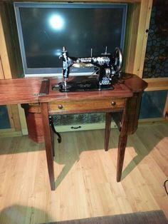 White rotary sewing machine and Martha Washington cabinet newly restored by us.