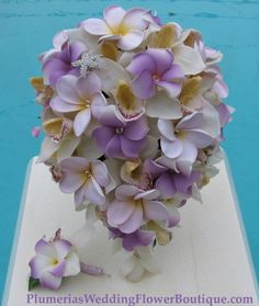 Lilac And Lavender Plumeria With Cream Orchids