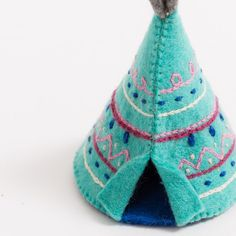 """Ancient wisdom in the circle home. Our teepee speaks of prairie days and nights, when the harvest was honorable and the community circle tight. Commemorate your tribe with this beautiful felt ornament. Looks lovely tied on a book, or bouquet of wildflowers. All details and stitching are hand-embroidered. Our ornaments come ready to hang with a string attached. Made from sustainably harvested, locally-sourced merino-blended wool. Fairly traded and made with love. H:3.75""""/9.5cm D:2.75""""/7cm Felt Crafts, Fabric Crafts, Diy Crafts, Christmas Crafts, Christmas Ideas, Felt Fabric, Felt Art, Felt Ornaments, Summer Crafts"""