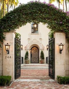 Beautiful entrance with a flowering vine arch.