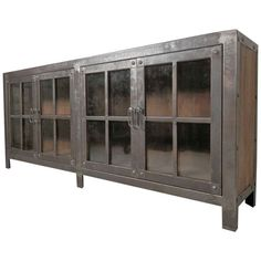 Machine Age Style Glass Door Console | From a unique collection of antique and modern cabinets at https://www.1stdibs.com/furniture/storage-case-pieces/cabinets/