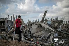 Mohammed Hussein, 20, on ruins of his home in #Gaza. He lost leg in #IsraelI attack that destroyed it(2). #Palestine