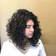 medium layered curly angled hair