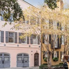 One Of Charleston's Historic Rainbow Row Houses Is On The Market   Wait until you see what's beyond these gates.   Originally published by Southern Living