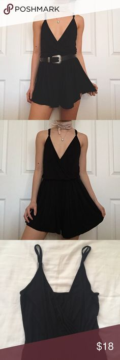 "Black Romper Good condition; was purchased here on Posh but realized black wasn't really my color; was said that it was bought from a boutique; unknown brand, size, & fabric content. Super cute and super soft though! Model is 5'1 with a 32A bust and a 24"" waist for reference. Has slight piling but isn't noticeable bc of the dark color. Looks like it could be from Urban Outfitters. Wrap front w/ plunging neckline & adjustable straps. Dresses"