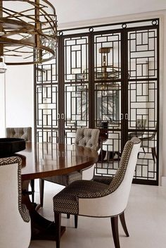 Love the fine line detail in this mirrored petition that tie into the fine lines of the light fixture. | Beautiful Kitchens and Dining Rooms