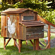 Reclaimed Rustic Coop With Painted Chicken I so want this for my finished backyard. Even though I'm terrified of chickens.