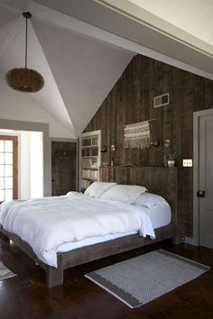 Master bedroom in a Catskills farmhouse remodeled by Jersey Ice Cream Co | Remodelista