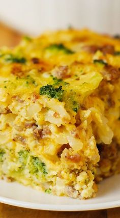 Breakfast Casserole with shredded hash brown potatoes, broccoli, cheddar cheese, sausage and eggs. Everything you want to have for breakfast in one easy casserole! Gluten free!