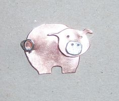 Copper pig brooch with sterling silver fastener, snout and curly tail. Handcrafted and available from Jewellery By Silvana