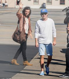 Niall and Harry at the airport as the band touched down in Adelaide, Australia. via MailOnline