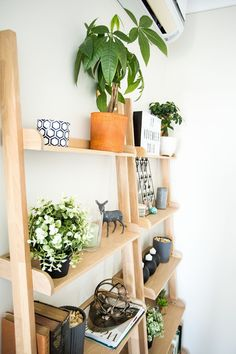 Wooden ladder shelves with old books and greenery ideal for bedroom Wooden Ladder Shelf, Ladder Shelves, Bedroom Apartment, Are You Happy, Greenery, Bookcase, Make It Yourself, House, Design