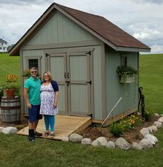 This neat 10x10 gable style shed was built by Paul standing here with his beautiful wife.  Awesome job with the landscaping, window flowerboxes, and nice color on the shed too! Thank you Paul for sending me a picture of your awesome shed!