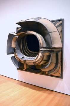 "Lee Bontecou wall sculpture - she did this series of dimensional pieces with ""voids"" that draw you in... some are made of fabric from military uniforms stretched over a wire frame. She is incredibly anti-war and these express the ""blackness"" of war and destruction. They are incredible in person"