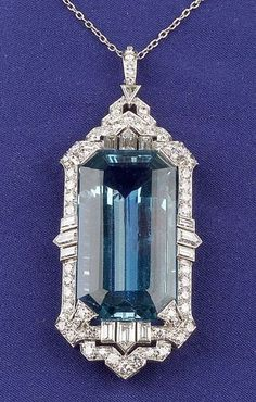 Art Deco Platinum, Aquamarine and Diamond Pendant, set with a step-cut aquamarine measuring approx. 23.20 x 16.55 x 10.10 mm, framed by eight baguette, four bullet, one triangular, fifty-eight full, and twelve single-cut diamonds
