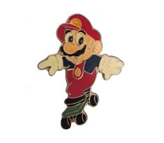 """1988 NINTENDO Super Mario Bros vintage video game enamel pin tie hat pinback skateboard by VintageTrafficUSA  15.00 USD  A vintage 1988 NINTENDO Mario pin Excellent condition. Measures: approx 1"""" Have some individuality = some flair! -------------------------------------------- Add inspiration to your bag tie jacket backpack hat or wall. 20 years old hard to find vintage high-quality cloisonne lapel/pin. Beautiful die struck metal pin with colored glass enamel filling. SECOND ITEM SHIPS…"""