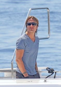 Keith Urban Photos Photos - Keith Urban enjoys the scenic view of the Cannes Harbor while aboard the Lady Joy yacht during the 65th annual Cannes Film Festival. - Arrivals at the amfAR Gala 2