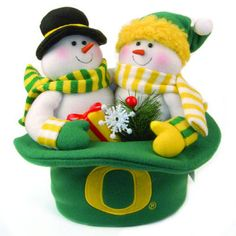 "Oregon Ducks Plush Snowman Top Hat Scottish Christmas. Place this Oregon Ducks Plush Snowman Top Hat on your table or windowsill and bring the holiday spirit to life. The unique top hat design features the Oregon Ducks logo and team name embroidered front and center. Great gift for couples Measures 12"" x 12"" Officially licensed Sports apparel that's great for any fan! This item ships same day if ordered by 4pm Central (M-F). This Product Makes a Great Holiday Gift!. Price: $32.99"