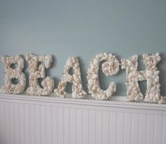 Here's an idea of what you can do with all the seashells you find on vacation. What you'll need: wooden letters, glue gun, and your shells. If your seashells are different colors, once glued to the letters, spray paint white for a modern look