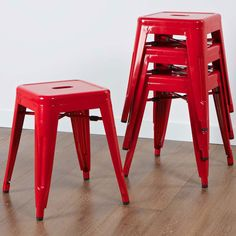 Bright red iron chairs.