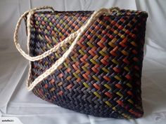 This beautiful Kete Whakairo is woven in Earthy tones of blue, green brown and red Harakeke, with Muka handles.