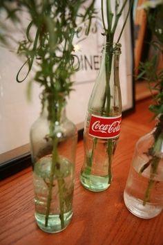 Vintage bottles and coca cola bottles as vases