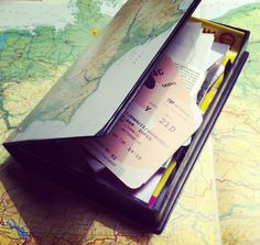 Cover an old VHS tape case with a map of your destination and use it to store mementos and tickets from each trip. These stack so easily on a bookshelf.