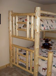 Bunk beds but with a darker wood