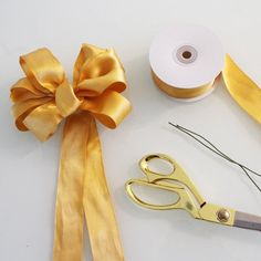 Learn how to make a bow with this short DIY video. This bow is perfect for holiday gifts, wreaths, or wedding decorations. Grab some ribbon and follow along bec