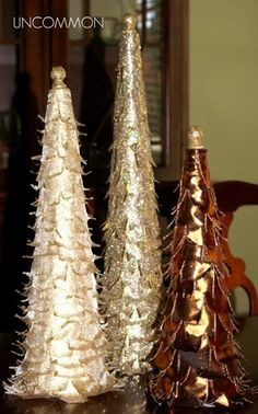 """Christmas Crafts - Table Top Tree DIY Projects: Glittery ribbon gives these trees a glamorous and elegant look. Wire ribbon allows you to curl the """"leaves"""". Top with an acorn finial covered in more glitter. Ribbon Tree Tutorial"""